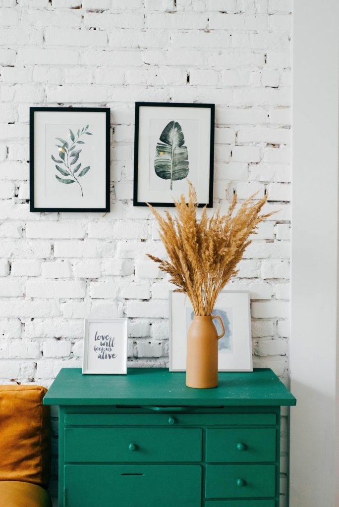 furniture in front of white brick wall