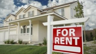 Real Estate for rent - decorative image of a house with a for rent sign.